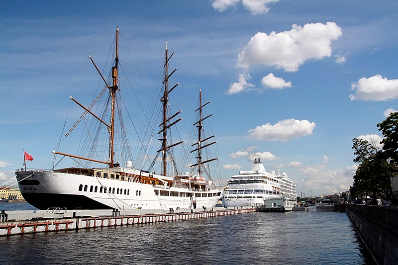 Cruise ships and sailing ships moored off the English Embankment in Saint-Petersburg, Russia