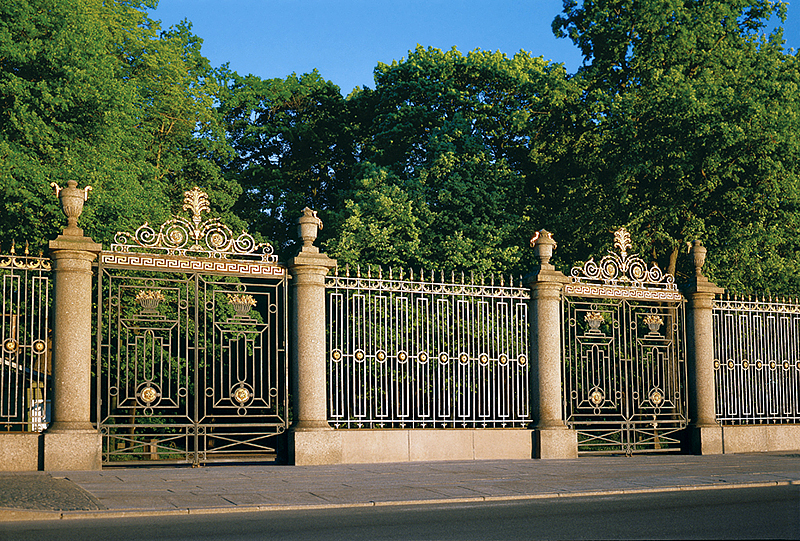 Palace Embankment and the wrought-iron fence of the Summer Garden in St Petersburg, Russia