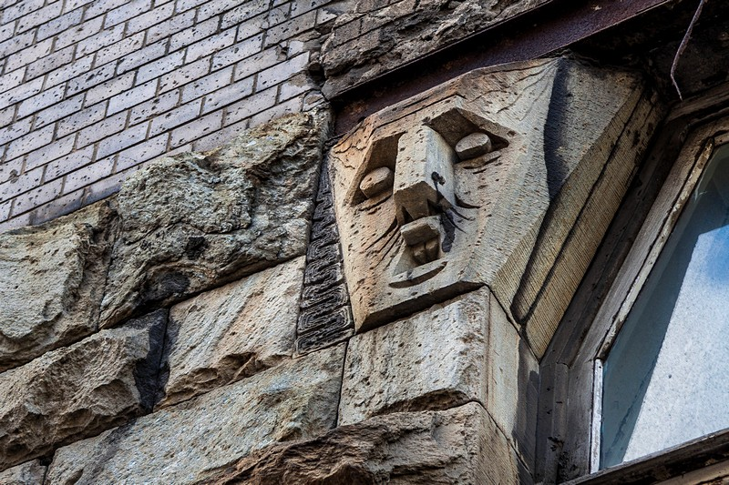 Stone faces on the Bubyr House in St Petersburg, Russia