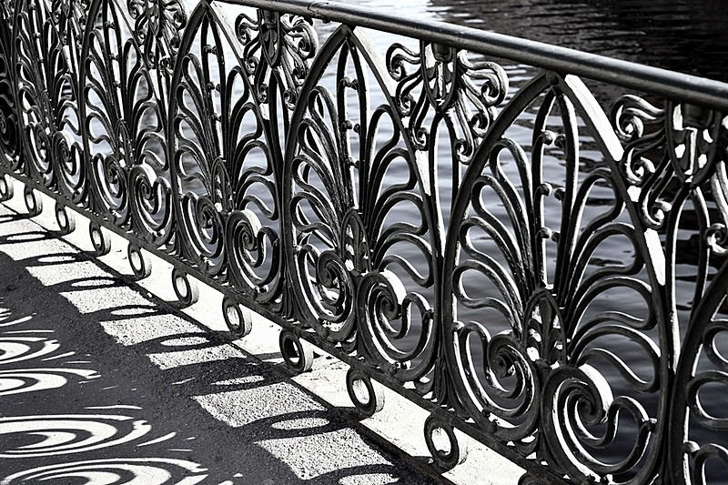 Wrought-iron railings of Demidov Bridge over the Griboedov Canal in St Petersburg, Russia