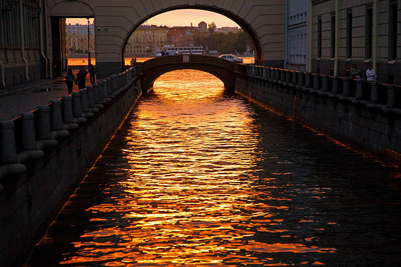 Hermitage Bridge and the Winter Channel at sunset in St Petersburg, Russia