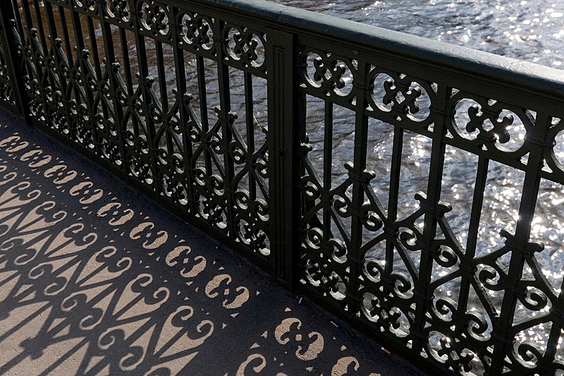 Wrought iron railings of Izmailovskiy Bridge over the Fontanka River in St Petersburg, Russia