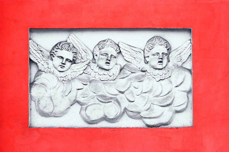 'Three cherubs' bas-relief on the wall of the church in St Petersburg, Russia