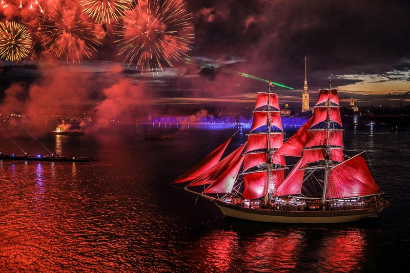 A ship with scarlet sails in front of the Peter and Paul Fortress in St. Petersburg, Russia