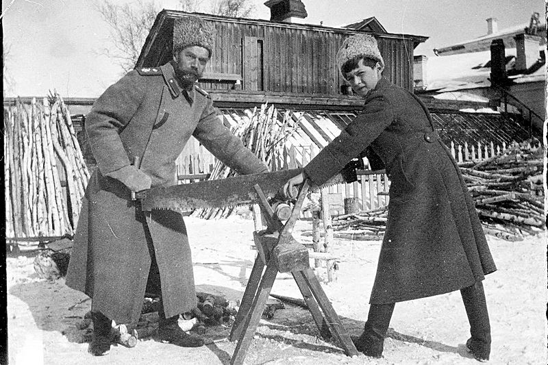 Snapshot by Grand Duchess Maria Nikolaevna of Nicholas II and Tsarevich Alexey Nikolaevich sawing wood at Tobolsk in 1917