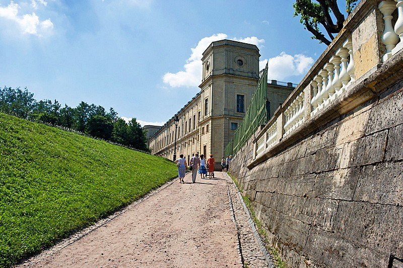 Visitors walking towards the Private Garden of the palace in Gatchina, royal estate south of St Petersburg, Russia