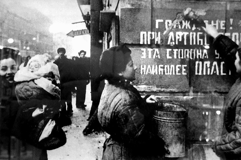 Exultant Leningrad. The siege is lifted. Sign on the wall says: Citizens! This part of the street is most dangerous during the artillery barrage, Russia