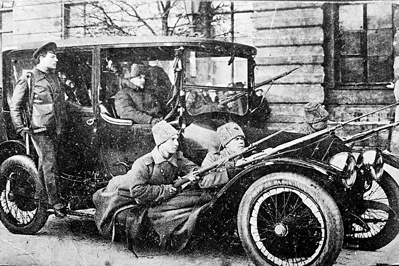 Car with armed soldiers and members of the city police in Petrograd, 1917, Russia