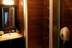 Bathroom of the Family Room (Three-Bedrooms) at the Pushka Inn Hotel in St. Petersburg