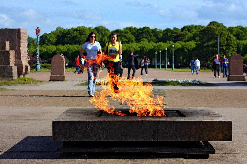 Eternal flame at the Monumnt to the Fallen Fighters of the Revolution on the Field of Mars in St Petersburg, Russia
