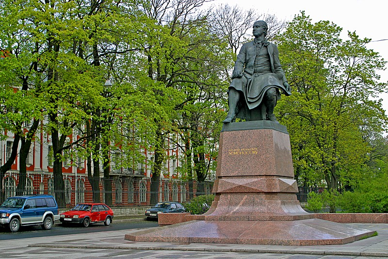 Monument to Mikhail Lomonosov (polymath) on Vasilevskiy Island next to the Twelve Colleges (St. Petersburg State University) in St Petersburg, Russia