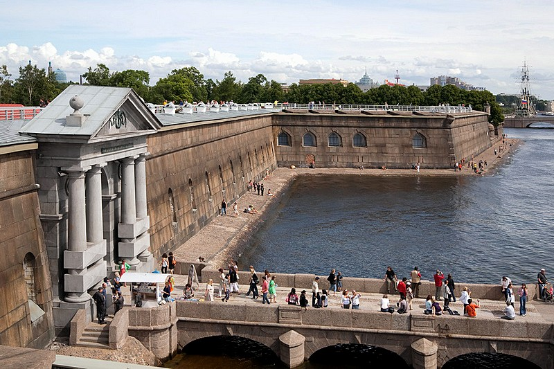 Visitors on the pier at the Peter and Paul Fortress in St Petersburg, Russia