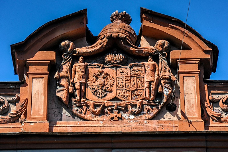 Old family crest on the pediment of the Palace of Grand Duchess Olga Alexandrovna (Baryatinsky Mansion) in Saint-Petersburg, Russia