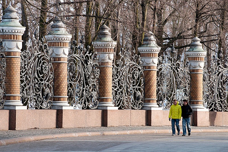 Winter view of Mikhailovsky Garden's wrought iron fence in Saint-Petersburg, Russia