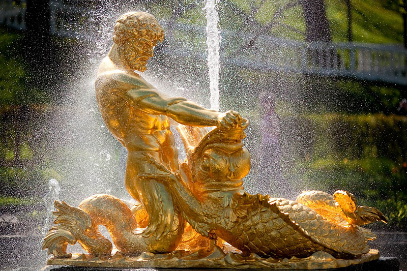 Oranzhereiny Fountain depicting a triton grappling with the jaws of sea monster in Peterhof, St Petersburg, Russia