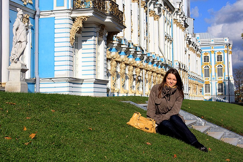Young lady in front of Catherine Palace in Tsarskoye Selo (Pushkin), south of St Petersburg, Russia