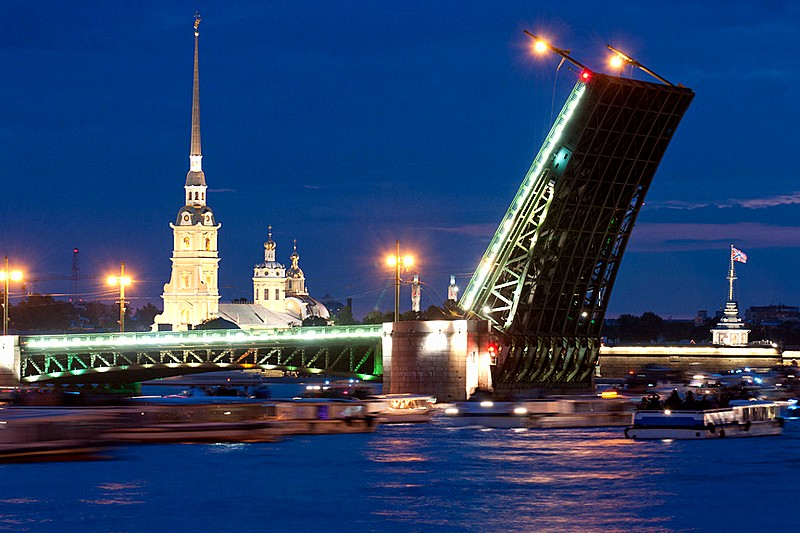 Raised 'wings' of Palace (Dvortsovy) Bridge and tour boats on Neva River in St Petersburg, Russia
