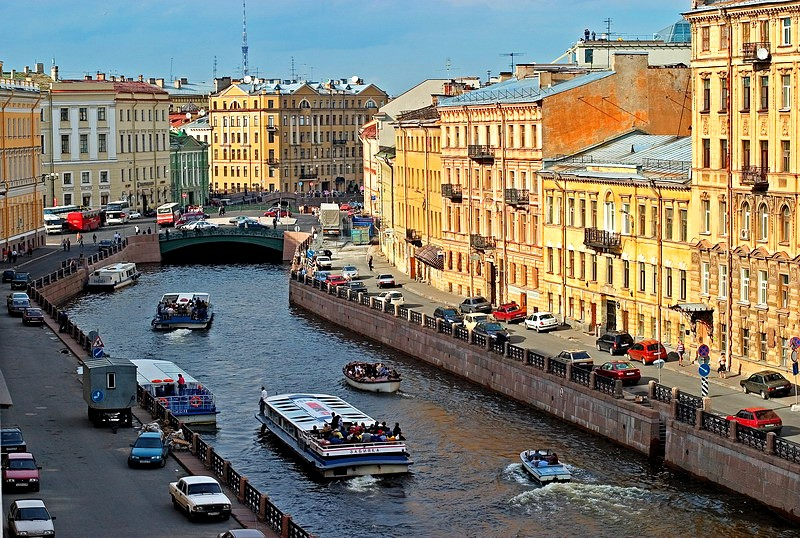 Small boats on the Moyka River in St Petersburg, Russia
